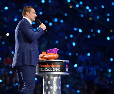 NFL player Rob Gronkowski speaks onstage