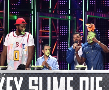NBA player Andre Drummond, jockey Victor Espinoza, host Russell Wilson, and NFL player Emmanuel Sanders participate in a key slime pie eating contest onstage