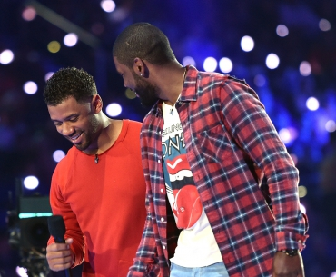 Host Russell Wilson (L) and NBA player Kyrie Irving