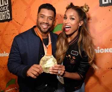 Host Russell Wilson (L) and recording artist Ciara pose backstage