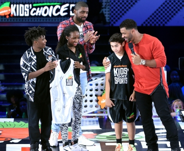 NBA player Kyrie Irving, $50K Triple Shot Challenge contestant Rey Fernandez and host Russell Wilson