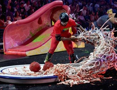 Host Chris Paul participates in a challenge