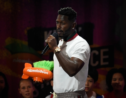 NFL player Antonio Brown accepts the hands of gold award