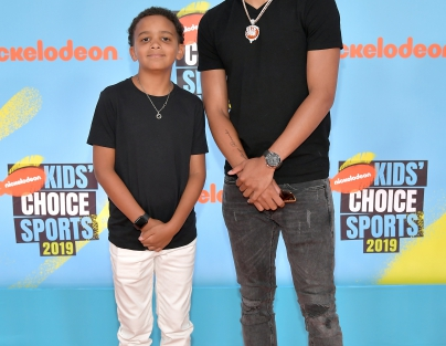 Trae Young (R) attends Nickelodeon Kids' Choice Sports 2019