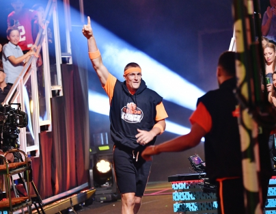 Rob Gronkowski participates in a challenge onstage