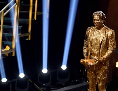 Dwyane Wade reacts after getting slimed while accepting the Legend Award