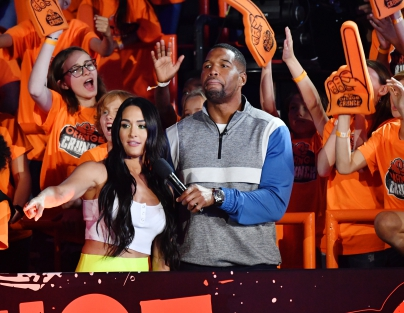 (L-R) Nikki Bella and host Michael Strahan speak onstage